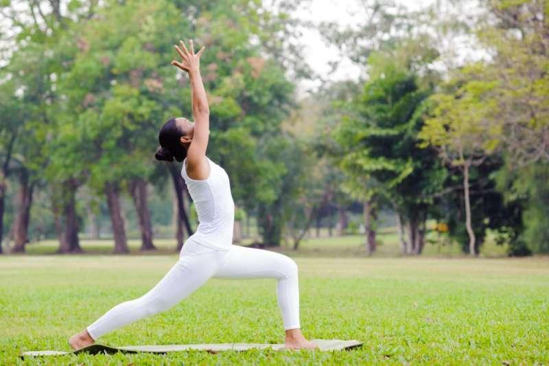 Person doing Yoga outside high